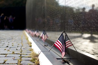 US Flags at the Vietnam Veterans Memorial Wall in Washington DC