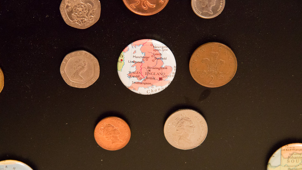 Map magnet of England and a display of British Pound coins