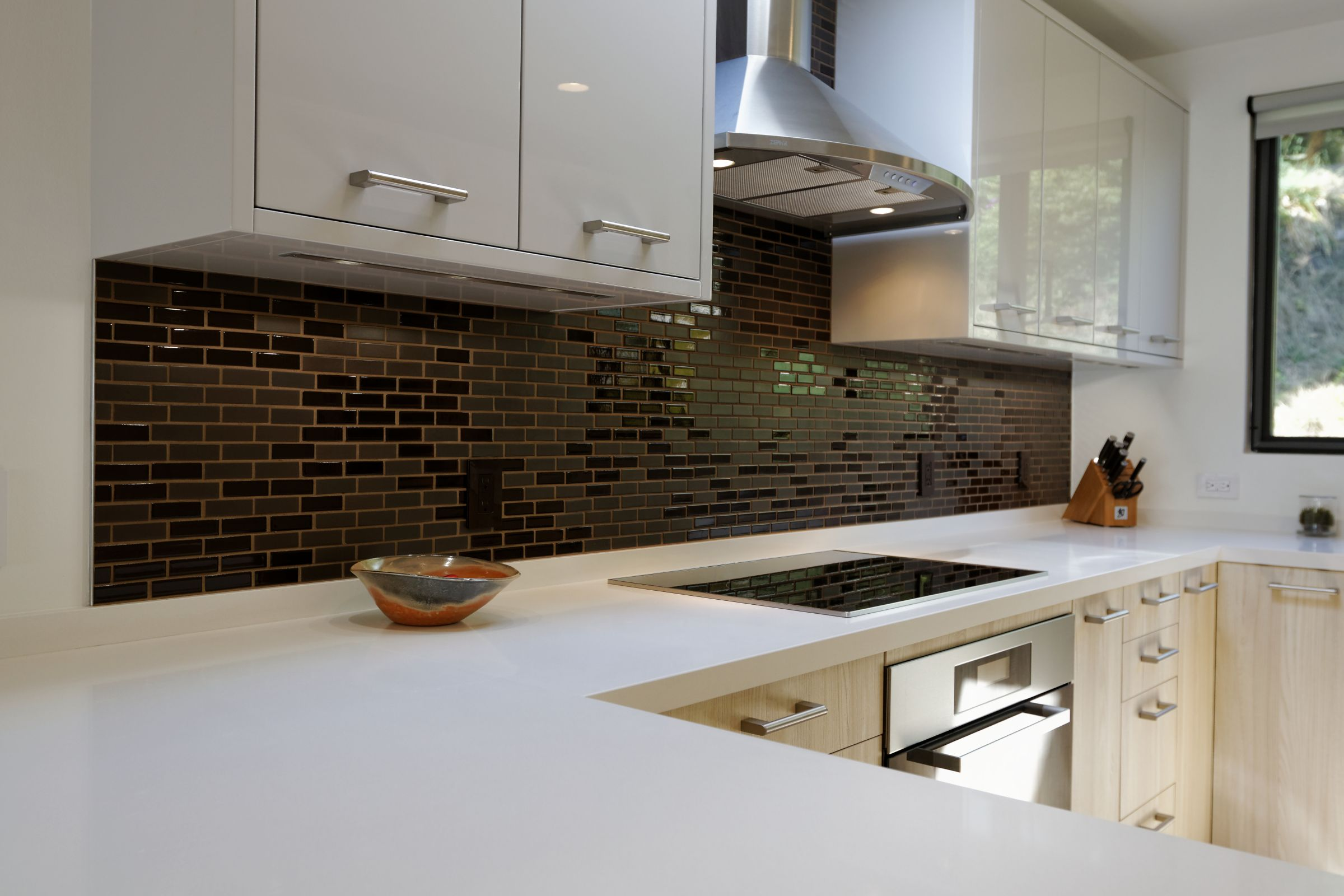 Typically the separate oven is more accurate that the ones integrated into free-standing ranges,