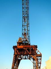 vehicle(0.0), mast(0.0), construction equipment(0.0), oil field(0.0), drilling rig(1.0), tower(1.0),