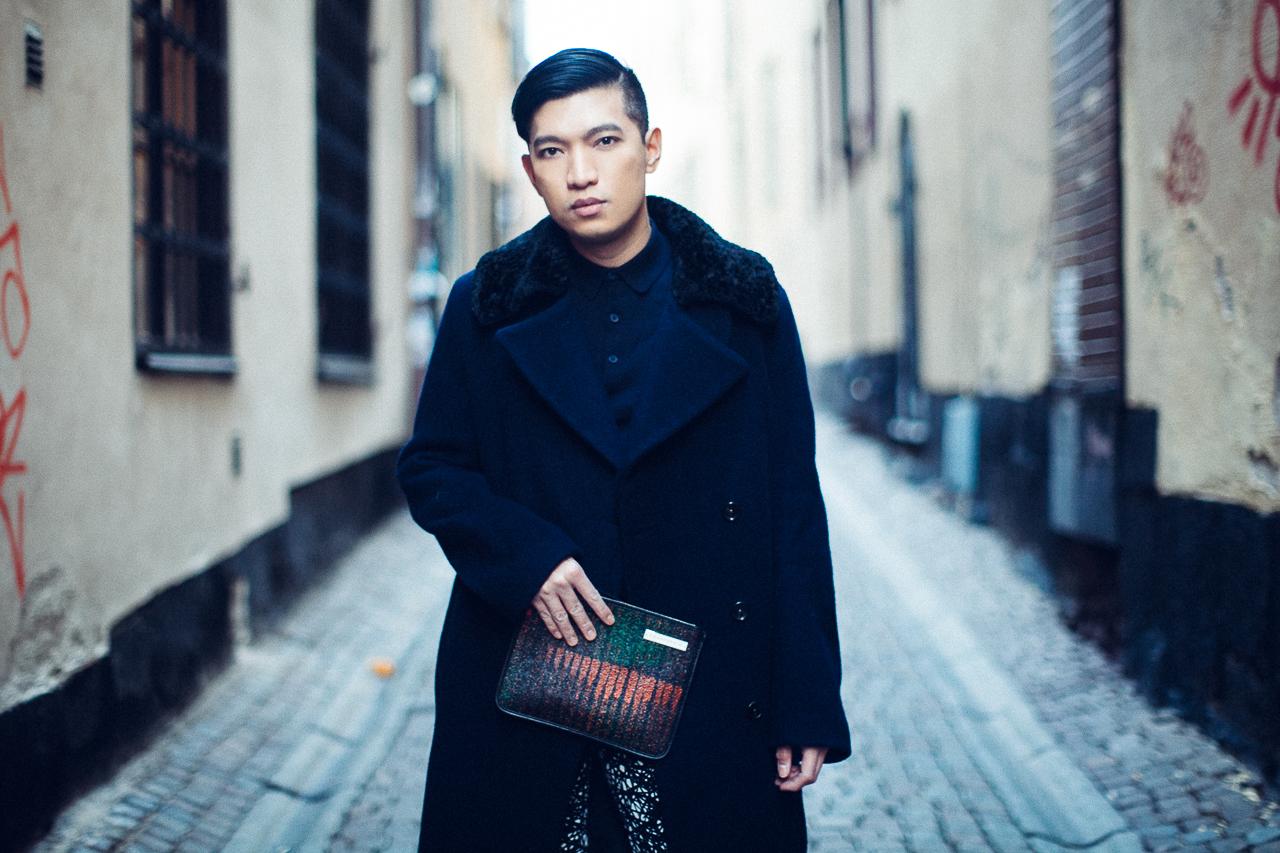 Bryanboy at Gamla Stan, Stockholm wearing an Acne Studios coat