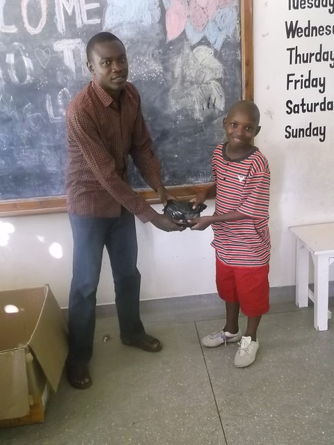 Hamisi receives his present
