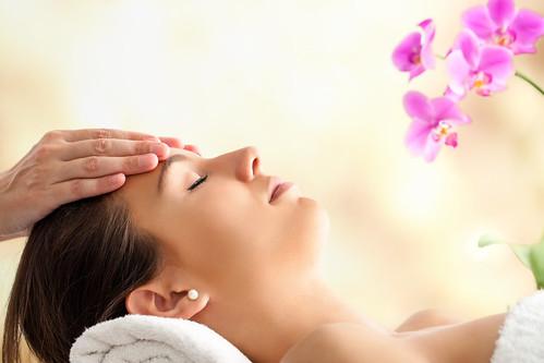 Female Facial massage in spa.