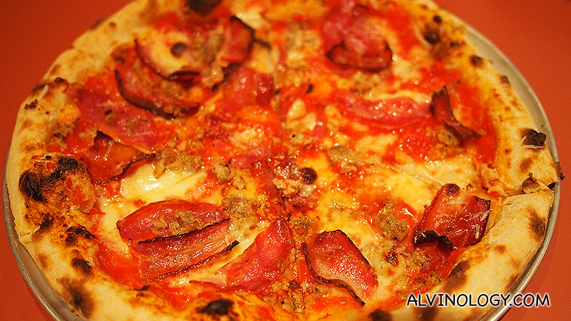 The Spotted Pig pizza tastes sinful with all that rendered fat and porky goodness on a crispy base