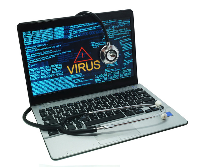 stethoscope on a laptop with virus