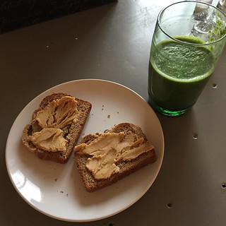 Homemade bread, homemade peanut butter, spinach, almond milk, orange smoothie. #potd