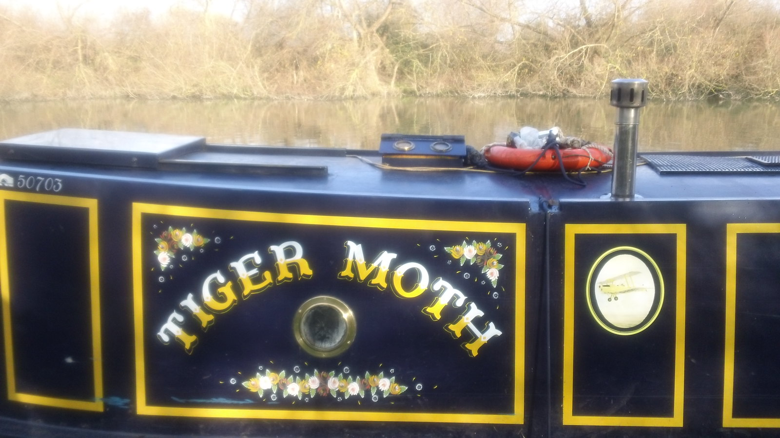 Tiger Moth on the Thames at Kings Meadow