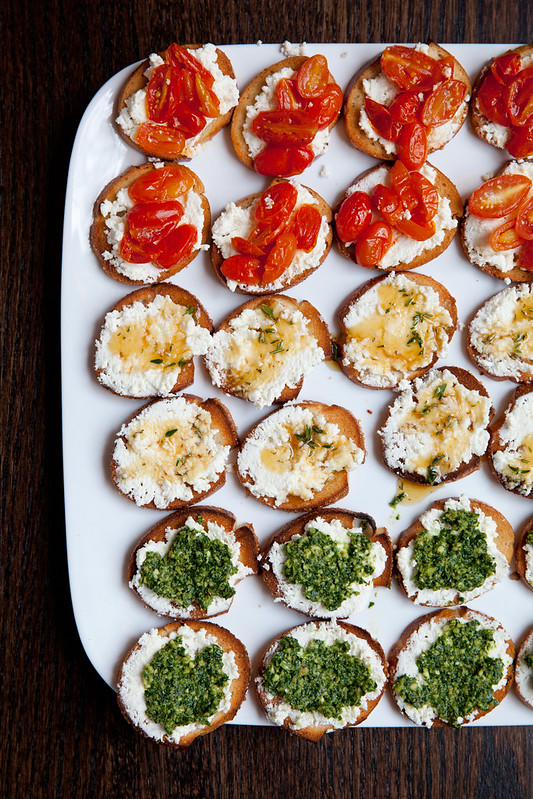 Trio of Crostini: Roasted Tomato, Herbed Honey, and Kale Pesto with Fresh Ricotta