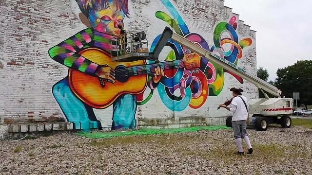 stan playing at agway mural