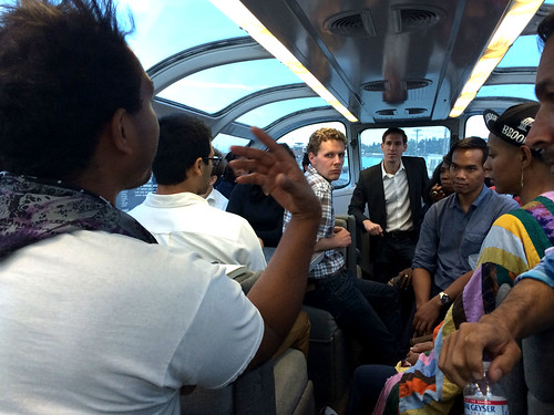 Participants in the Millennial Trains Project enjoy an onboard mentoring session with Andy Rabens, Special Advisor for Global Youth Issues at the U.S. State Department as the train passes through Washington's Puget Sound. (Courtesy Millennial Trains Project. Used with permission)