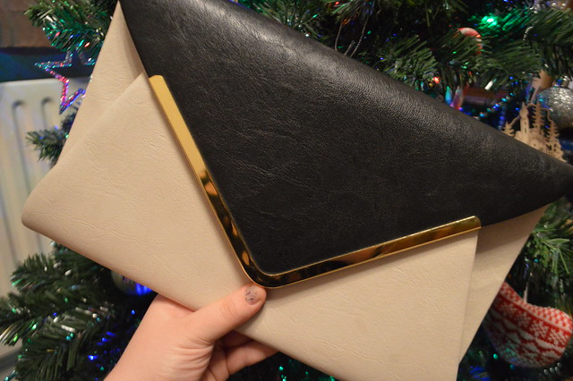 This is a photo of a black and cream clutch bag