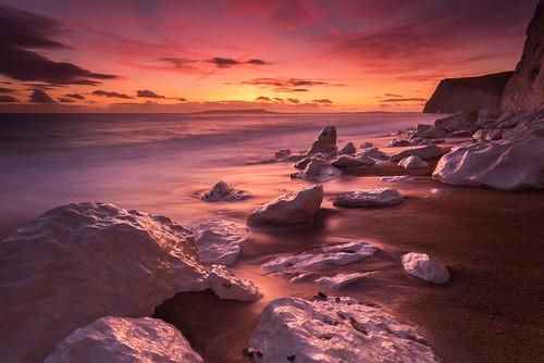 winter sunset cloud white colour chalk rocks hole unitedkingdom head cliffs dorset bats afterglow westlulworth