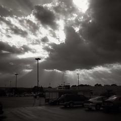 God rays at Walmart parking lot! #godrays #walmart #sky #clouds #sunset #blackandwhite #blackandwhitephotography @eduardontavares