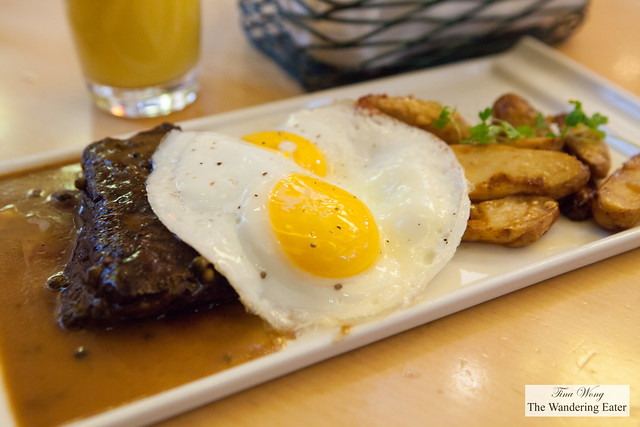 Steak and eggs with a side of potatoes