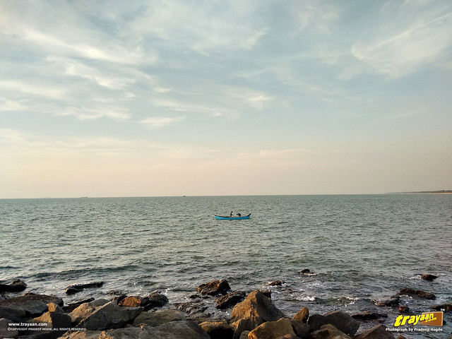 Fishermen on their boat on an evening in Panambur Beach, Mangalore, Mangaluru, Dakshina Kannada, Karnataka, India