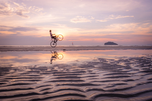sunset color reflection beach bike bicycle wheel silhouette sailboat one kid sand cambodia pentax pop riding wheelie k5 otres smcpda15mmf40edal