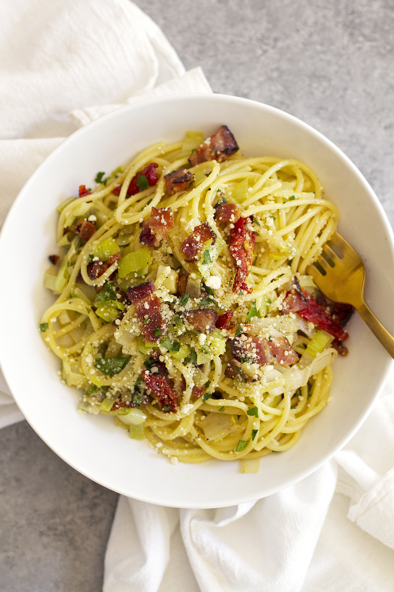 Pasta Carbonara with Leeks and Sun-Dried Tomatoes | girlversusdough.com @girlversusdough