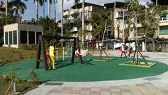 sport venue(0.0), miniature golf(0.0), town square(0.0), outdoor play equipment(1.0), recreation(1.0), outdoor recreation(1.0), leisure(1.0), residential area(1.0), city(1.0), public space(1.0), plaza(1.0), playground(1.0), neighbourhood(1.0),