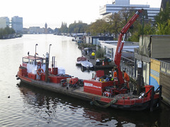 dredging(0.0), tugboat(0.0), machine(1.0), vehicle(1.0), ship(1.0), channel(1.0), watercraft(1.0), barge(1.0), boat(1.0), waterway(1.0),