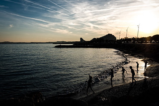 Image of Plage La Madrague. sunset sky france beach children contrails cagnessurmer provencealpescôtedazur marinabaiedesanges