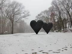 Snowy field with two hearts