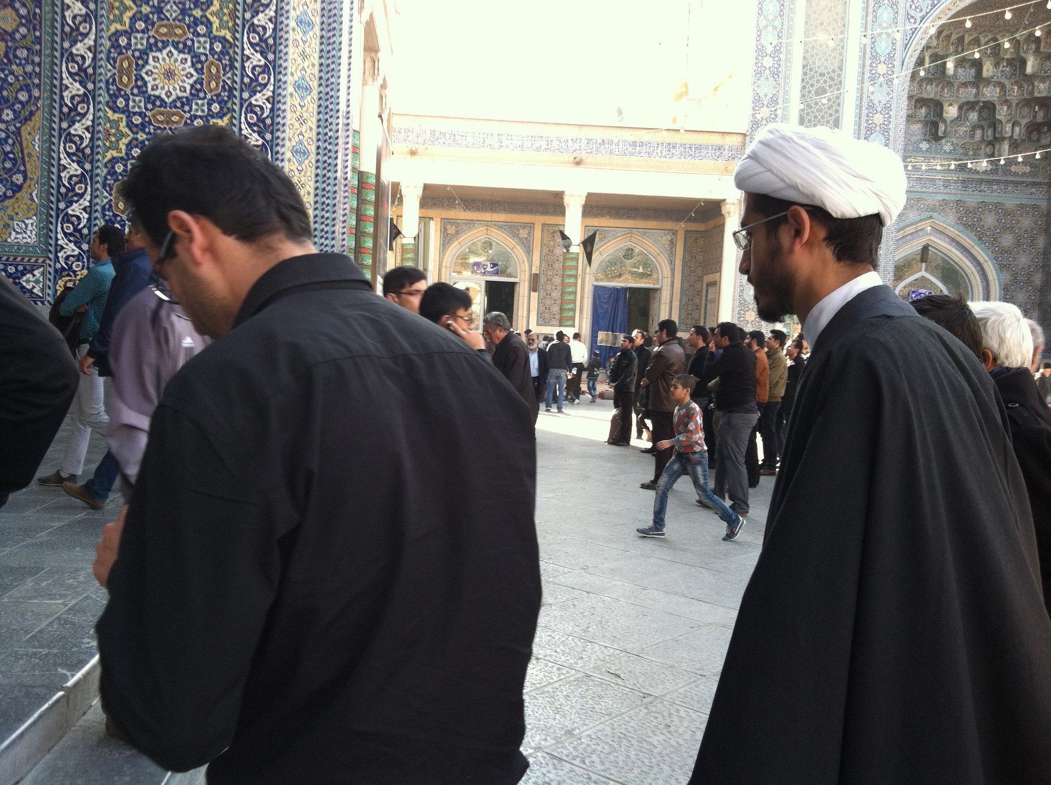 Men enter the Mosque to Pray. Qom, Iran