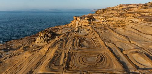 morning water rock sunrise rocks patterns australia pacificocean coastal nsw newsouthwales geology centralcoast puttybeach 2014 bouddinationalpark sonynex6 spanreunion