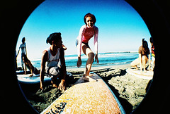 photomontage(0.0), sea(1.0), photograph(1.0), leisure(1.0), fisheye lens(1.0), photo shoot(1.0), surfboard(1.0),