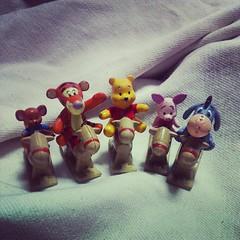 小熊維尼家族坐木馬。