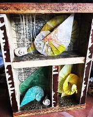 Spiral themed box made in Gina Adams Encaustic Divination workshop at Studio Joy. @ginaadamsartist #encaustic #kansascity #studiojoy #assemblage #spiral #origami #tomokofuse #shell #paperfolding #amandajolley