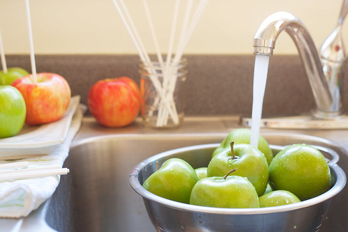 washing apples with water in a sink