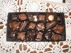 baking(0.0), chocolate cake(0.0), fudge(0.0), chocolate truffle(1.0), confectionery(1.0), bonbon(1.0), produce(1.0), food(1.0), chocolate brownie(1.0), chocolate(1.0), cuisine(1.0), praline(1.0),