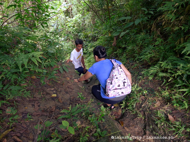 Going down the steep part of the trail. Hiking to Dalipuga Falls in Iligan City, Philippines