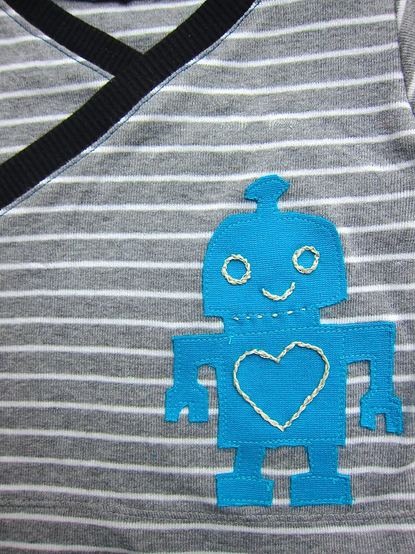 Blue robot knit appliqué closeup