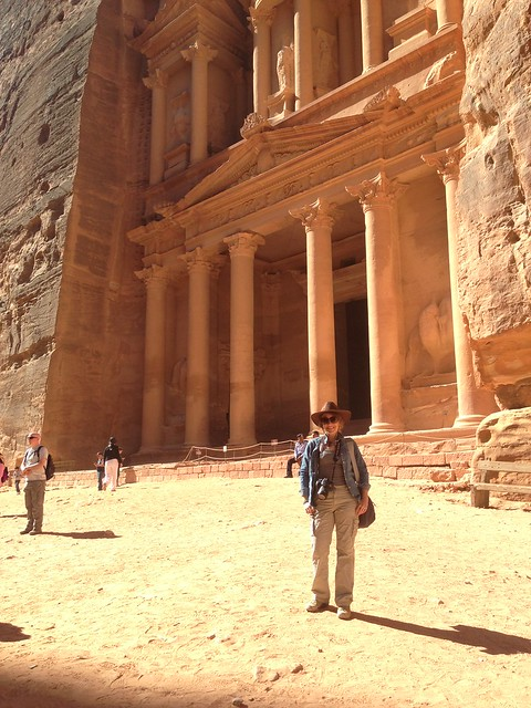 Rachelle standing at Petra in a long sleeve shirt, pants and a hat.