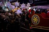 Children follow Santa's sleigh - sponsored by The Teddington and Hamptons Rotary Club - with their handmade lanterns