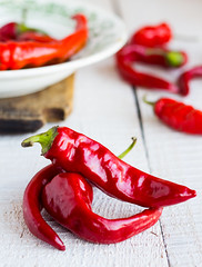 whole red chili pepper on a white background