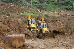 logging(0.0), asphalt(0.0), agriculture(0.0), field(0.0), road(0.0), off-roading(0.0), construction(0.0), infrastructure(0.0), soil(1.0), landslide(1.0), vehicle(1.0), geology(1.0), construction equipment(1.0), bulldozer(1.0), quarry(1.0),