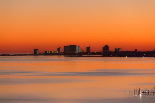 ocean sunset orange sun color reflection water canon buildings october gulf bright florida vibrant pensacola waterway intercoastal perdido gulfcoast perdidokey t5i cloudsstormssunsetssunrises