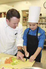 Chef for a Day: Chef Neal Cox of The Houstonian Hotel works in his kitchen alongside Ivan Marquez. Ivan is a Matthys Elementary fourth-grader and winner of our 2013 My Favorite Holiday Food Writing Contest. Spending a day with Chef Cox was his prize.