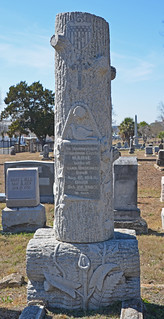 Woodmen of the World grave monument with dove