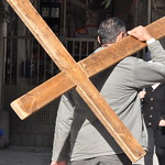 A man carrying a cross on the Via Delorosa