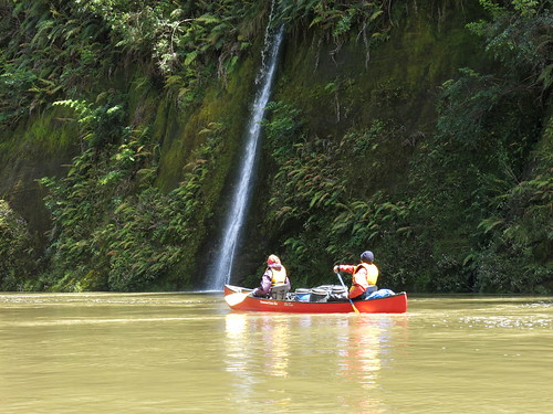 Canoe and Waterfall on Whanganui River