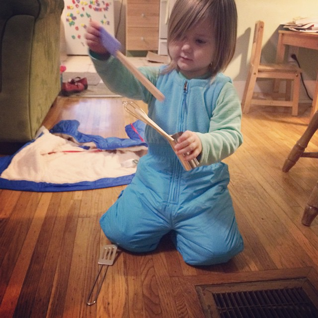 Birthday girl enjoys her new snowpants and some of her new kitchen tools. #mybabyis3