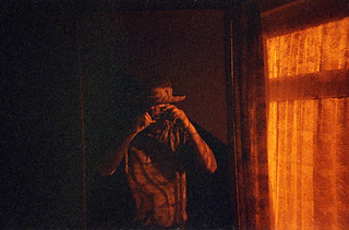 reflected self-portrait with Rollei Nightbird camera and straw hat
