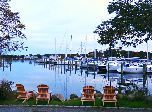 usa water america port marina boats evening harbor us seaside waterfront unitedstates chairs connecticut newengland bayside sailboats atlanticocean watercraft mystic eastcoast groton yachtclub mysticseaport adirondackchairs sandraleidholdt mysticharbor leidholdt grotonlongpointyachtclub