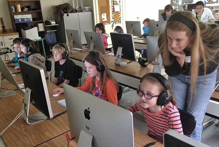Laura Davey, a computer scientist in the Laboratory's High Performance Computing Division, assists students during Hour of Code tutorials.