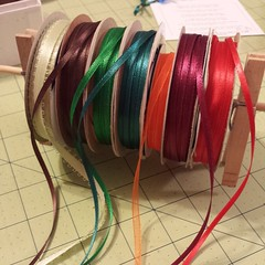 I need to cut a bunch of ribbon all the same size. This is what I worked out so I can do a bunch at once!