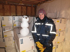 Mindy Nicewonger standing next to insulated shipping container (ISC) boxes filled with 1-meter long sections of ice cores.