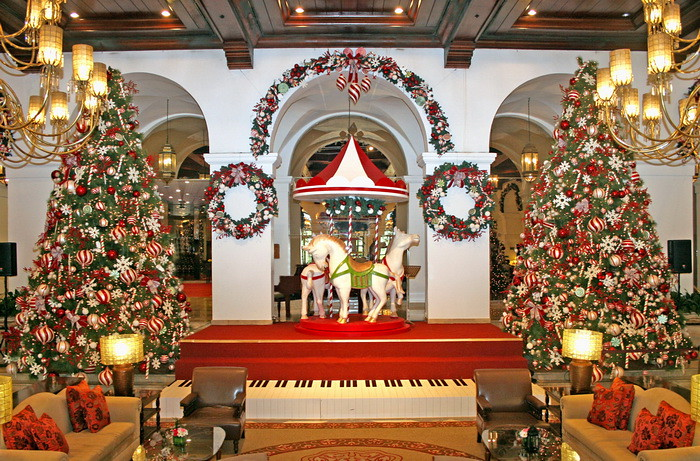attractions at the lobby are definitely the two spectacular 22 feet christmas trees decked in shimmering hues of red white and green candy ornaments